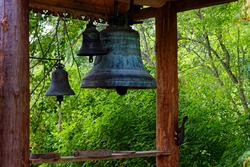 Small belfry in the courtyard of a village house in the countryside in Russia.