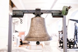 Small bell hanging on a metal carcass