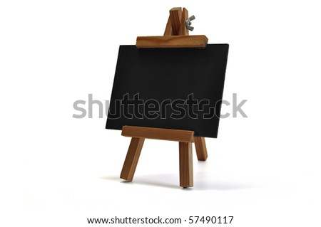 Small blackboard on easel for your text - might be a restaurant´s menu, announcing a special offer or opening of a new store, a back to school announcement or whatever you want to communicate. - stock photo