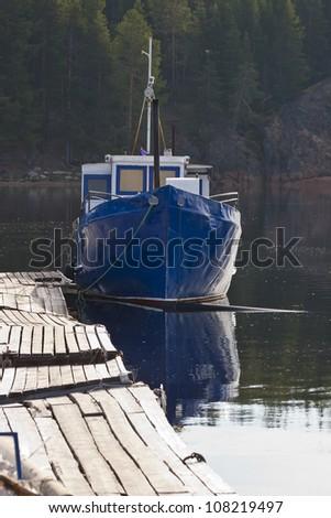 Small blue boat near beach