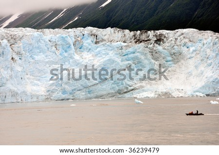 small boat at giant glacier