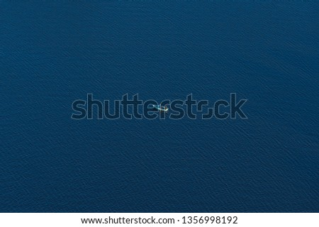 Small boat in the endless ocean #1356998192