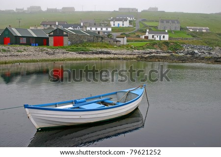 Small boat on a misty day near Lerwick, Shetland Islands - stock photo