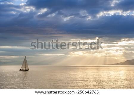 Small boat sailing on Leman lake, Switzerland.