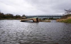 Small boat sunk in a river
