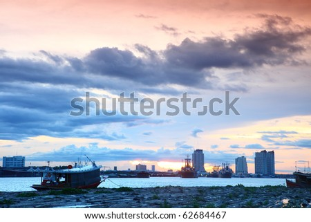 Small boat with a beautiful fall sunset sky