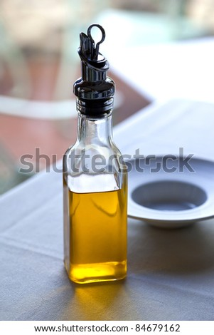 Small bottle of olive oil on a restaurant table