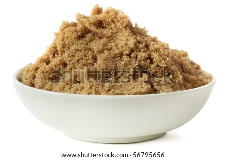 Small bowl of brown sugar, isolated on white.