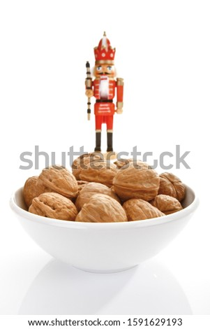Small bowl of walnuts with a nutcracker figur