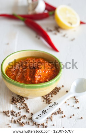 Small bowls of homemade harissa with red chili