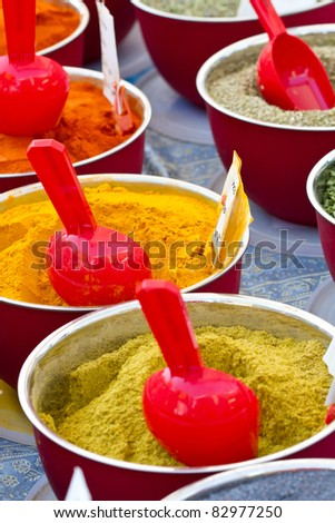 small boxes with different spices in market - stock photo