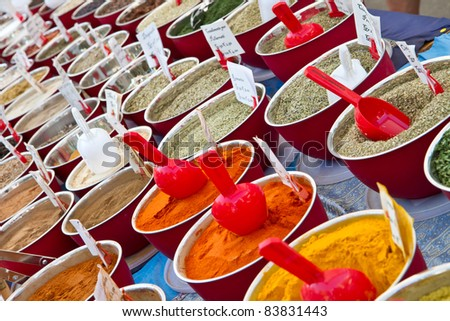 small boxes with different spices in market