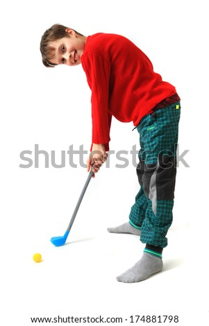 small boy and golf toy