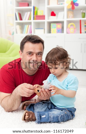 Small boy and his father spending time together playing
