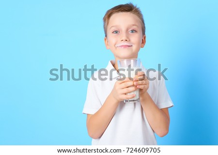 small boy drink a glass of milk with different emotions on blue background #724609705