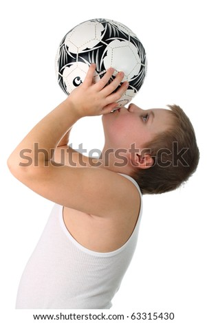 Small boy kissing the football ball isolated on white