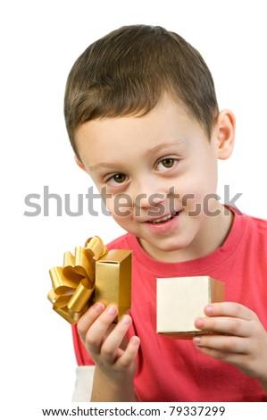 small boy looking inside box
