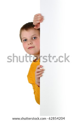 Small boy looks out of blank billboard isolated on white