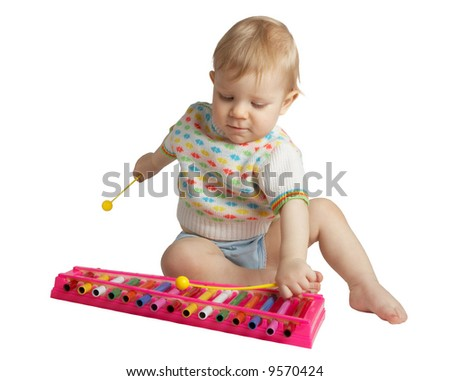 Small boy plays a musical toy