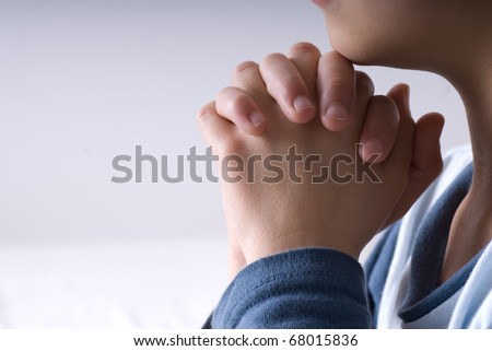 Small boy praying before going to bed
