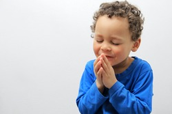 small boy praying stock photo