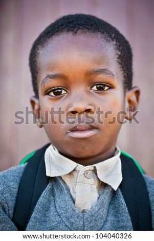 Small boy very scared to go to school for the first time.