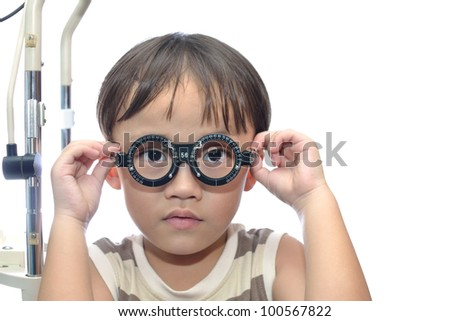 Small boy with eye examination.