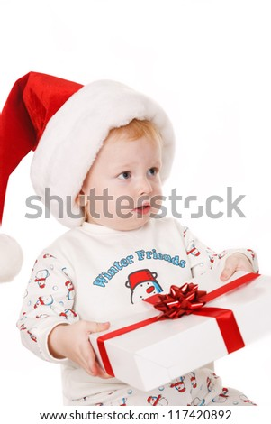 Small boy with Santa hat  holding  Christmas gift
