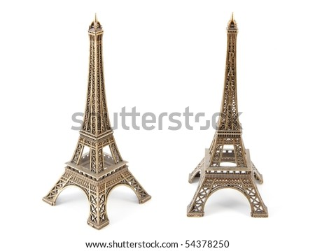 Small bronze copy of Eiffel Towers, isolated on white