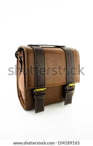 small brown leather bag isolated on white background - stock photo