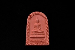 small Buddha image amulet carrying for luck and  remember to do good thing translation is required for the non-English text is named of Buddha is Luang Por Pakdand mean buddha with red mouth