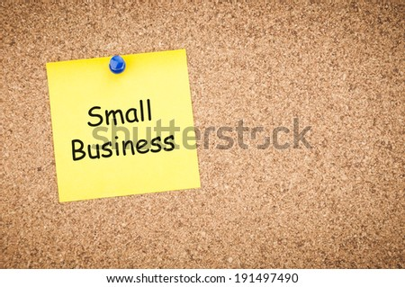 small business concept, sticky pinned to cork board with room for text.