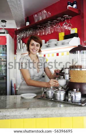small business: female owner or waitress making coffee
