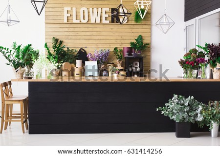 Small business, Flowers delivery. Modern flower shop interior, reception desk. Floral design studio, sale of decorations and arrangements.