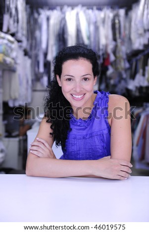small business: happy owner of a dry cleaner store