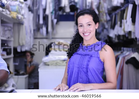 small business: happy owner of a dry cleaning service