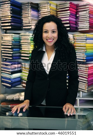 small business: happy owner of a fabric store