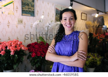 small business: happy owner of a flower shop - stock photo