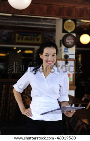 small business: happy owner of a restaurant