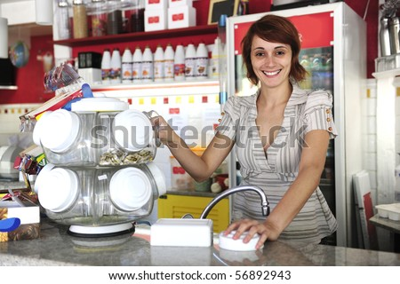 small business: happy waitress selling candy