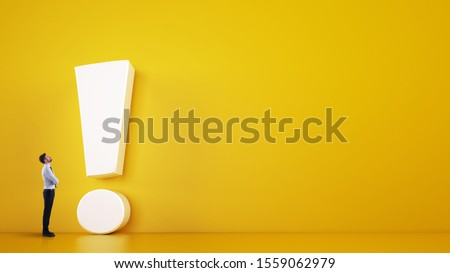 Small business man looks at a big white exclamation mark on a yellow background. 3D Rendering Foto d'archivio ©