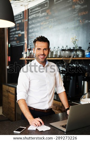 Small business owner calculating revenue