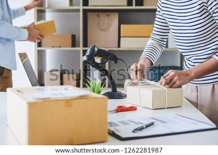 Small business owner delivery service and working packing box, business owner working checking order to confirm before sending customer in post office, Shipment Online Sales. #1262281987