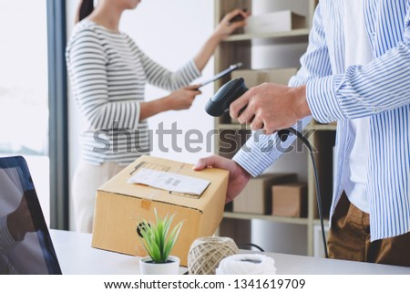 Small business owner delivery service and working packing box, business owner working checking order to confirm before sending customer in post office, Shipment Online Sales. #1341619709