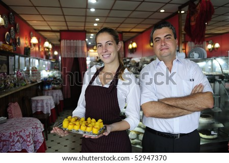 small business: owner of a cafe and waitress with pastry - stock photo