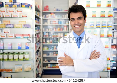 small business owner: portrait of a male pharmacist at pharmacy - stock photo