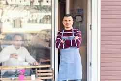 Small business owner smiling at entrance door for reopening of street coffee shop after lockdown quarantine due to coronavirus - Entrepeneur open cafe activity to support local businesses.