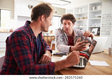 Small business partners using computers at home