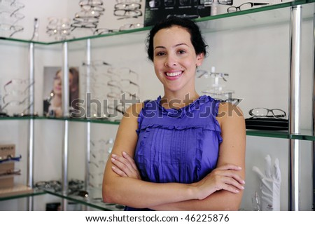 small business: portrait of an optometrist inside her store