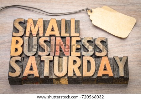 Small Business Saturday word abstract - text in vintage letterpress wood type with a blank price tag, holiday shopping concept